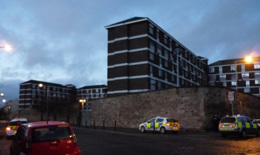 Fort House with police cars from North Fort Street
