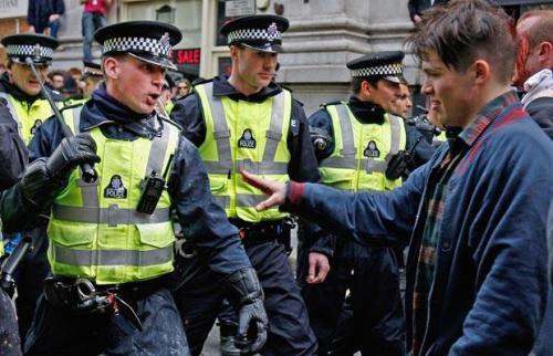 Metropolitan Police confront bleeding protesters