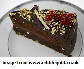 gold leaf chocolate cake with red berries