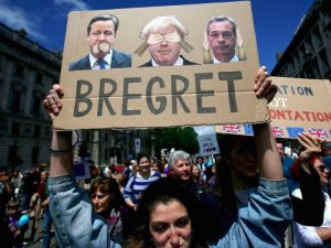 Pro-eu protester holding up BREGRET sign