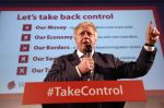 Boris Johnson in front of a Take Back Control poster